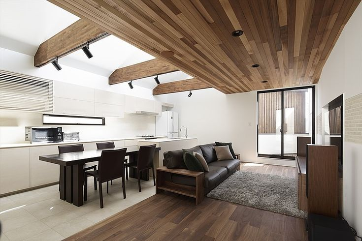 Surround sound in the living room.  In ceiling rear speakers, hidden subwoofer, aesthetically pleasing towers, recessed TV.  Wood and beams.  Light. 45° House by TSC Architects