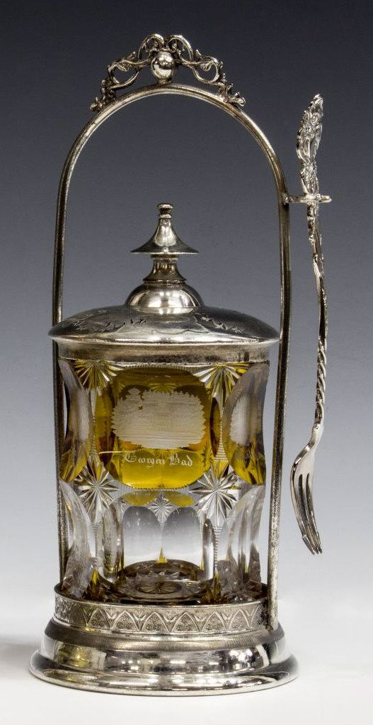 Plated pickle castor with a Victorian silver plate frame holding an unassociated cut to clear jar, with applied silver lid.