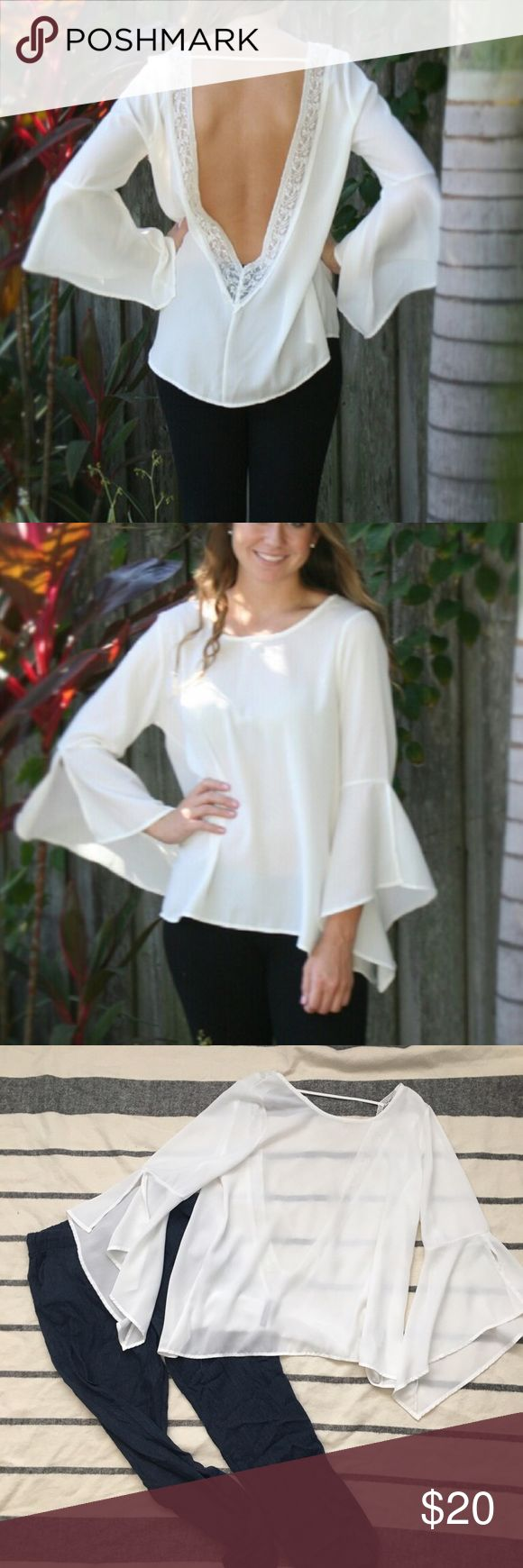 Open Back Bell Sleeve Blouse This top is perfect for summer! In good condition, only worn a few times. This top is so unique, it has a big open back with delicate lace trim, and trendy bell sleeves. You'll definitely want to wear a sticky bra or pretty bralette with this since it is somewhat shear. Not Lulus, but a similar boutique  👋 PLEASE READ 👋 - I accept reasonable offers unless noted - Lowballers will be ignored - ❌trades - ❌ 🅿️🅿️ - I don't discuss lowest price through the…