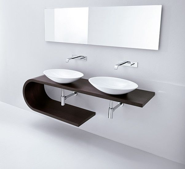 #Jey by #MastellaDesign: #bathroom console in #wengé in different sizes. Taking inspiration from the sinuous geometry of the alphabet letter, Jey is a two-tier console for countertop #basins that provides ample space. Clean lines, simple structure, elegant softly curved wood.    SIZE: L 130 cm min 175 cm max D 42 cm H 48 cm  MATERIAL: wengé  INSTALLATION: wall mount    Discover more on design2taste.com