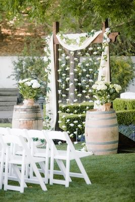 Sweet wedding backdrop with floating flowers | Arches and Chuppahs: 19 Gorgeous Wedding Arbors and Canopies via @insideweddings