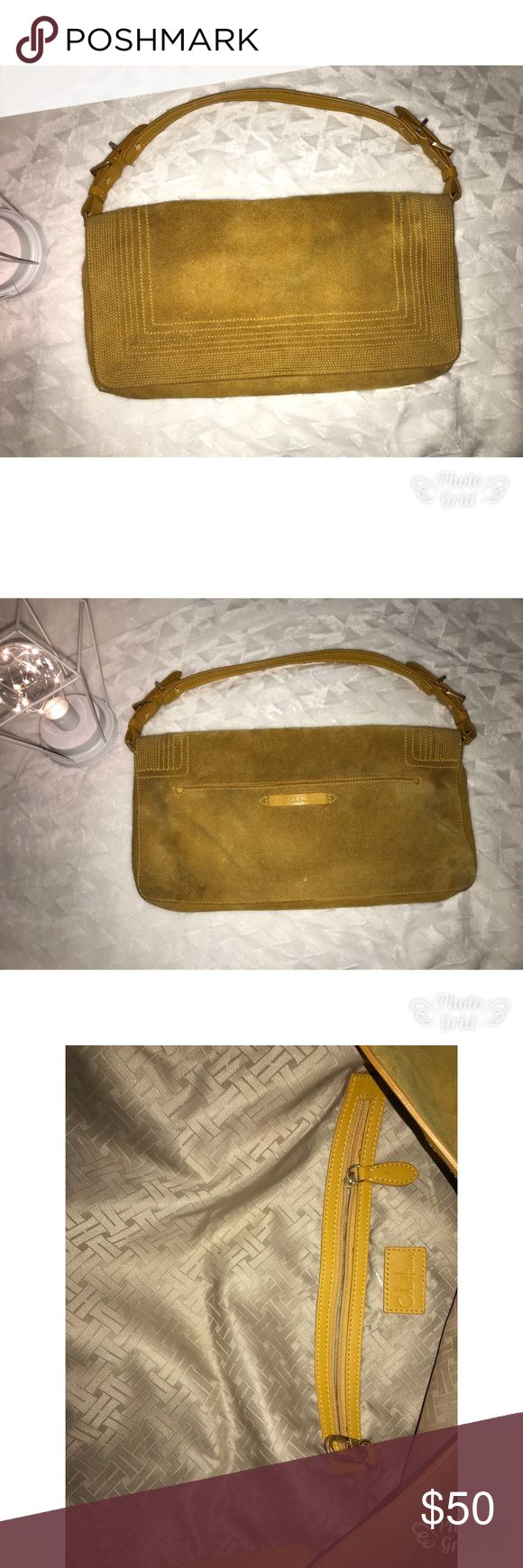 Cole Haan mustard suede shoulder clutch/ purse 👛 Cute Cole Haan leather suede shoulder bag .  Can be used for a clutch bag if you put the straps in side.  Has little marks in need of a little suede cleaner . Beautiful and unique mustard color. Cole Haan Bags Shoulder Bags
