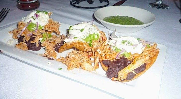... tostadas with black refried beans, green tomatillo sause, queso fresco