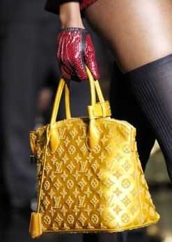 Louis Vuitton FW2011: Patent lambskin bag with wool monogram stitching... AAAHH-MAZING.