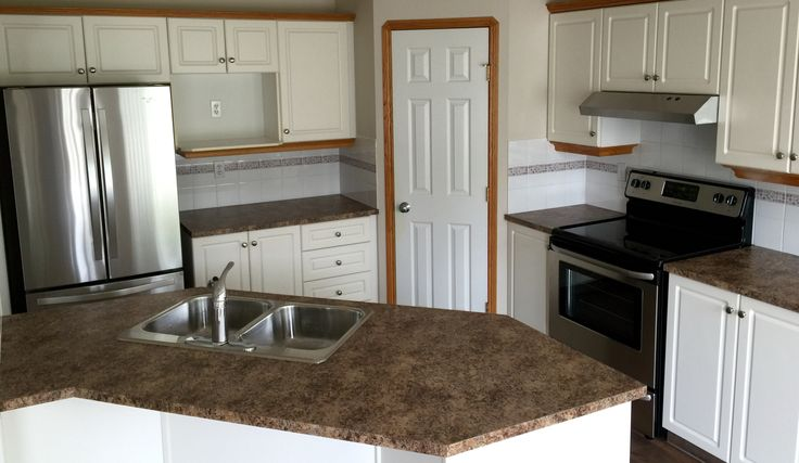 On this Reno we replaced the counter tops, sink, faucet, hood fan and dishwasher. We can get any size Reno done.