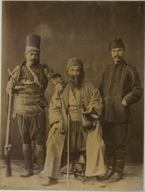 """Three different Turks"".  Ca. 1880, Late-Ottoman Empire. From left to right: a 'başıbozuk' (irregular soldier of the Ottoman army), a beggar (holding up his left hand) and – probably - a lower-rank military of the regular army, on leave."