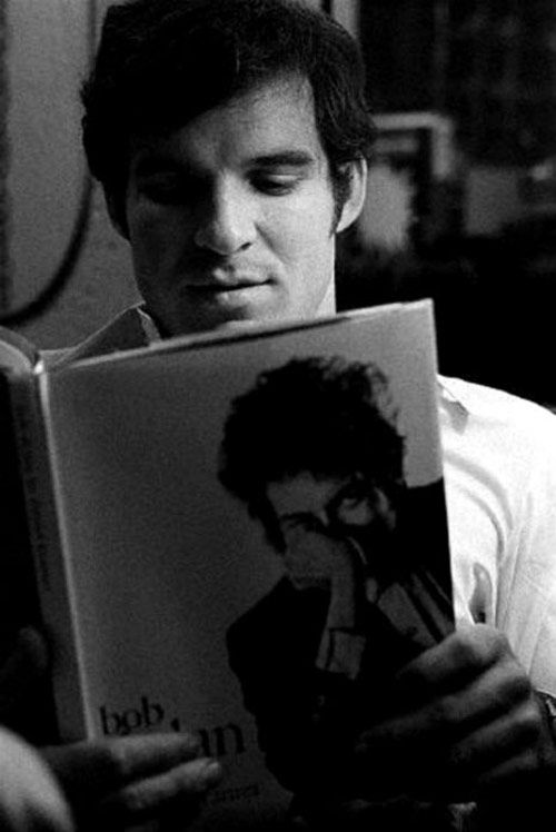 Steve Martin/Bob Dylan - from Photos of Celebrities Reading Books About Other Celebrities on flavorwire.com