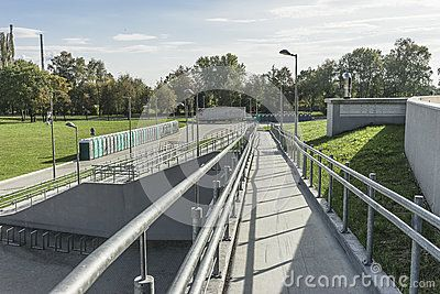 Concrete access for the disabled people , entrance to the Sports Hall Tauron arena in Krakow , Poland . In the time of autumn.