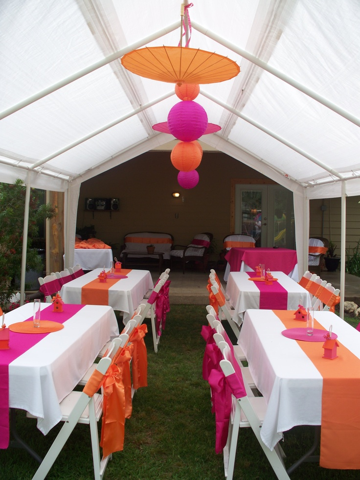 pink and orange baby shower... I love the set up just think the center piece could be better..