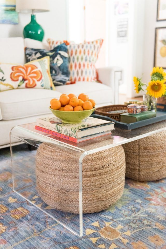 3 (Simple) Decorating Looks I Love (woven ottomans tucked under an acrylic coffee table; design by Amanda Louise Interiors)