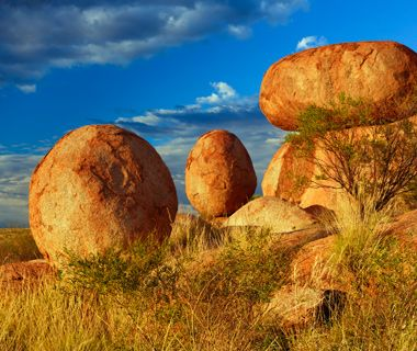 Devils Marbles, Australia Known to the Aborigines as a sacred place called Karlu Karlu, the Devils Marbles Conservation Reserve gives Ayers Rock some serious competition as the Northern Territory's most iconic site. Most photos focus on just two of the rocks, but there are actually many more of these prehistoric rust-colored granite boulders—some of which can be as large as 20 feet in diameter—strewn over an area of 4,400 acres.