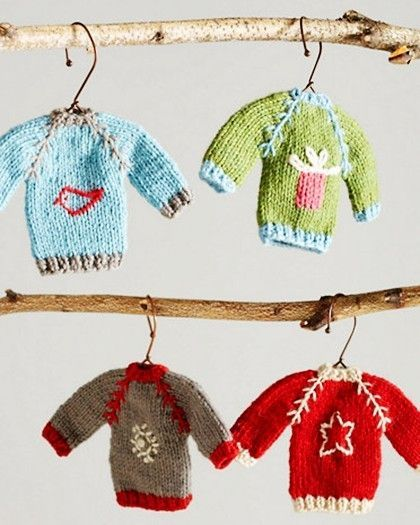 Don't want traditional Christmas ornaments? Why not hang a few sweaters instead?