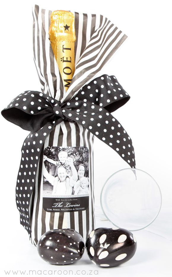Special occasions deserve a bottle of champagne - wrapped in tissue paper and finished off with matching ribbon and a personalised sticker  http://www.macaroon.co/macaroon/content/en/macaroon/photo-gift-stickers