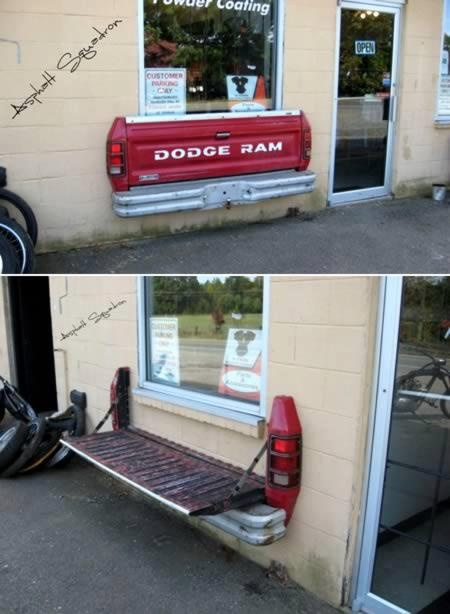 Fold up bench made from old truck tailgate.