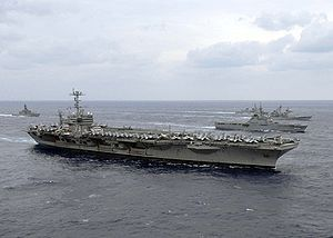 USS George Washington participating in a photo exercise with other U.S. Navy and Japan Maritime Self-Defense Force ships ...
