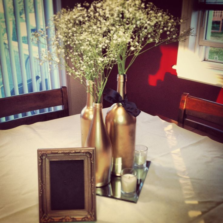 centre piece spray painted wine bottles gold with baby 39 s breath wedding inspiration. Black Bedroom Furniture Sets. Home Design Ideas