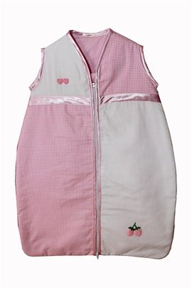 Beautiful pink gingham baby sleeping bag. Sizes 0-36 months. Satin trim to arms, neck and zip edge. Two layers of soft cotton with cosy inner batting. Central zip from bottom to top for ease of changing.