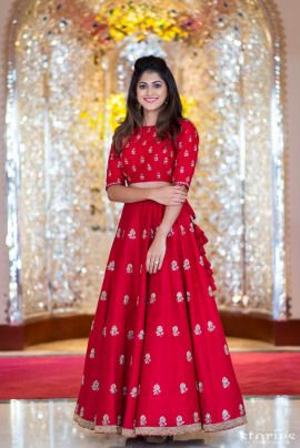 Light Lehengas - Dhrumil & Anusha (Muscat) | WedMeGood | Bride in a Light Red Lehenga with Small Booties #wedmegood #indianbride #indianwedding #bridal #lehenga #lightlehenga #redlehenga #lehenga