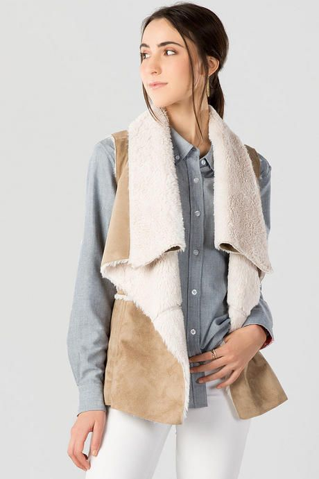 """Soft+&+stylish+is+the+Quinn+Faux+Shearling+Vest. +Soft+faux+suede+makes+up+this+draped+vest+lined+with+faux+fur.+Style+over+a+button+down+blouse+with+a+pair+of+jeans+&+boots+for+a+finished+fall+look.<br+/> <br+/> -+28""""+length+from+shoulder+to+hem<br+/> -+36""""+chest<br+/> -+measured+from+a+size+small<br+/> <br+/> -+Shell+face:+100%+Polyester;+Shell+back:+100%+Polyester<br+/> -+Machine+Wash+Gentle<br+/> -+Imported"""