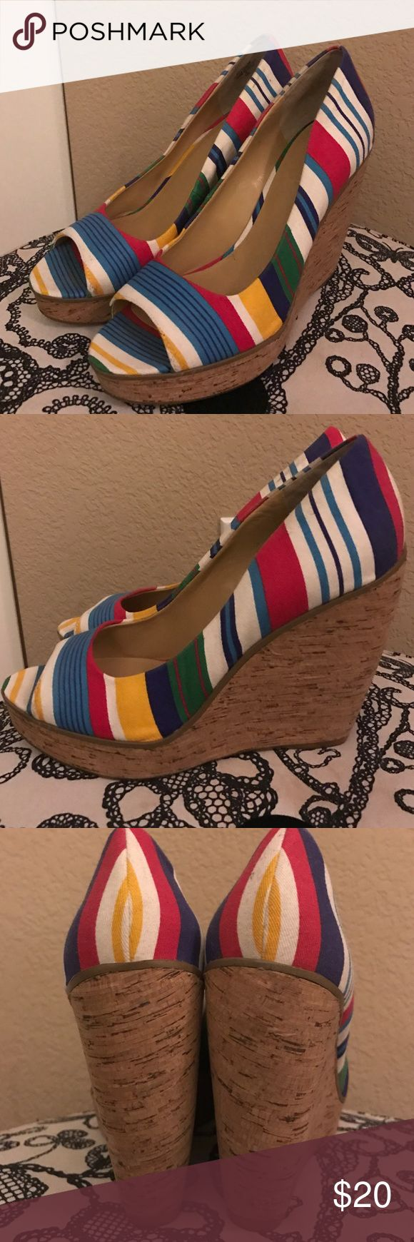 Nine West striped wedges These open toed wedges are in great condition! With the multi colored striped they go with so many outfits! Cork wedge makes them easy to wear! Get ready for spring! Nine West Shoes Wedges