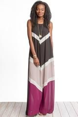 Sleeveless color block maxi in blackand plum. Lined. Back is solid color. Silk/Polyester blend.