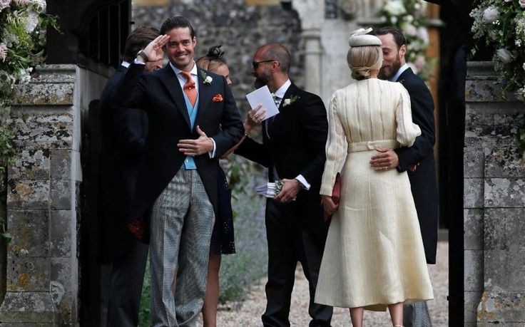 Spencer Matthews, centre, stands at the entrance of St Mark's Church in Englefield, England, for the wedding of Pippa Middleton and his brother James Matthews