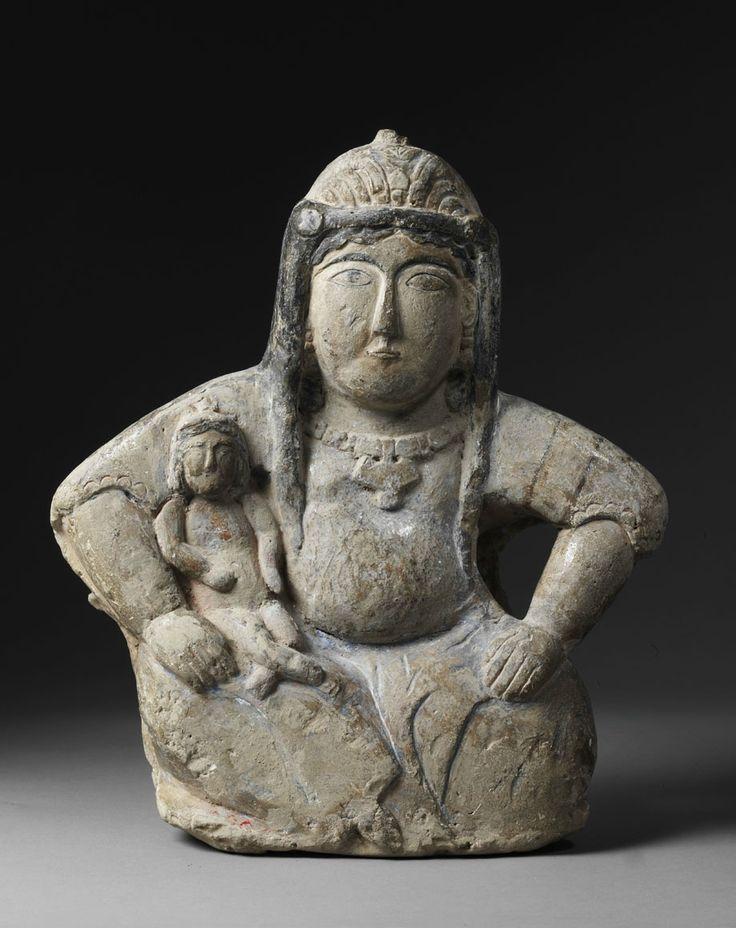 Monumental Seated Mother. Circa 1200 A.D., Seljuq Dynasty, Iran.   31 cm (12 1/4 in.).