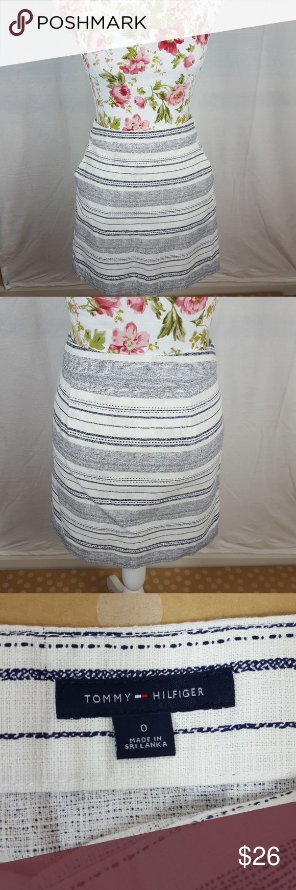 TOMMY HILFIGER Blue and White Cotton Linen Skirt This skirt has wonderful stippled stripes going across horizontally. An expertly Hidden Side zip topped with a hook and eye and pockets. Perfect condition.  Waist: 15 inches laying flat Length: 17 inches Tommy Hilfiger Skirts
