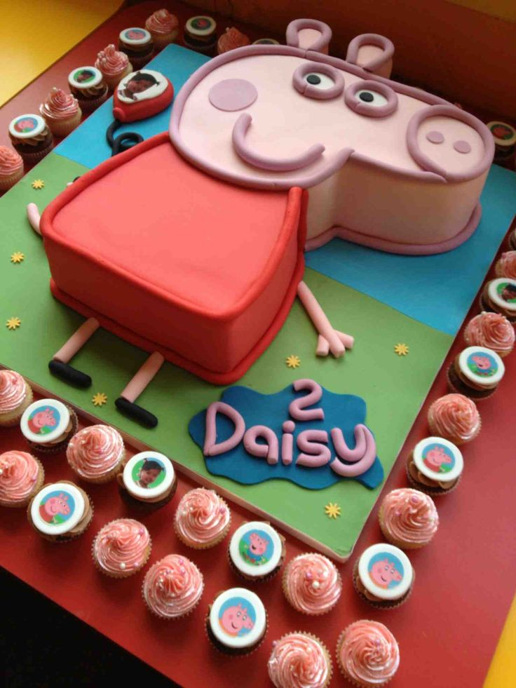 Pepper pig cake idea. What about this, the main cake can be healthy for kids and the cupcakes could be normal for adults???