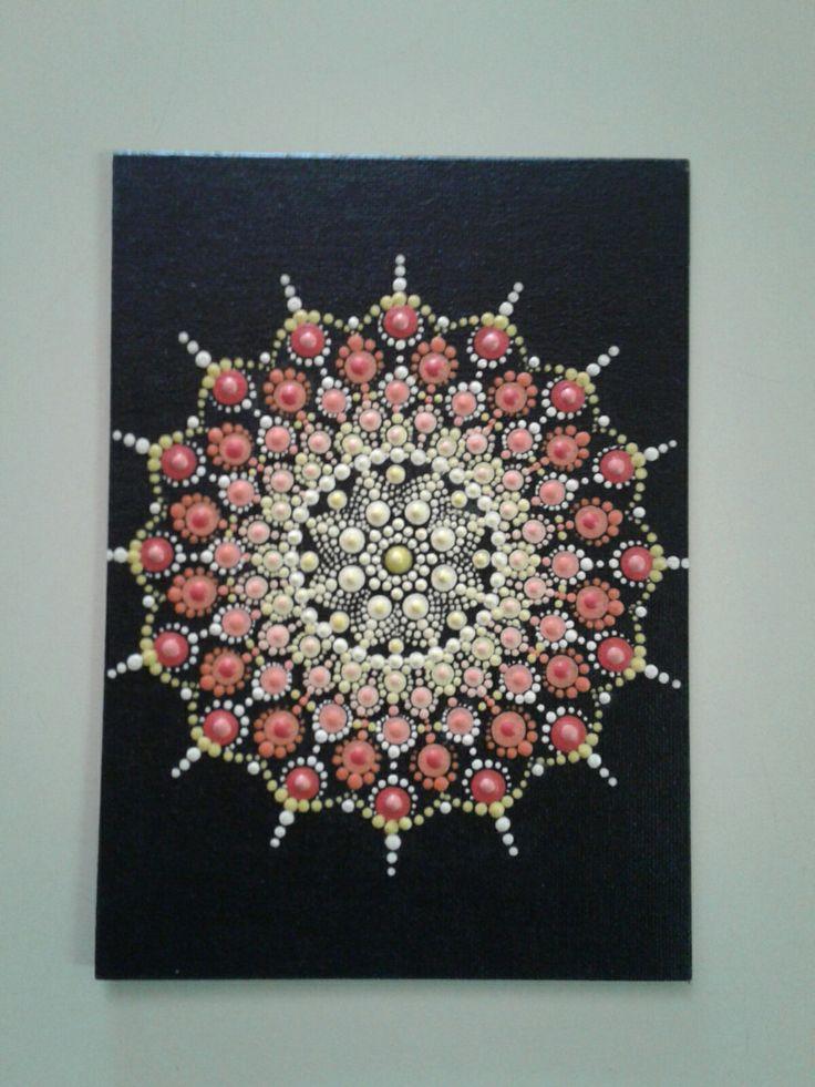Mandala painted on a canvas board