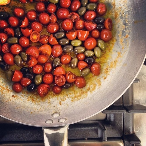 Trying a new recipe #cherrytomatoes #garlic #olives