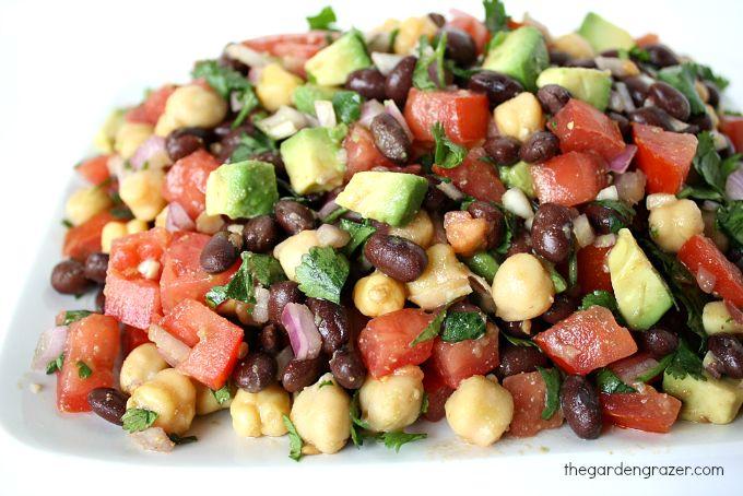 Fiesta Bean Salad - garbanzo beans, black beans, roma tomatoes, red onion, fresh cilantro, avocado, optional add-ins (bell pepper, jalapeno, corn, etc.), dressing (olive oil, lime, garlic cloves, cumin, salt)