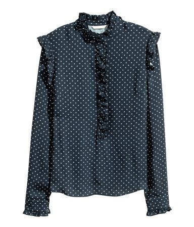 Dark blue/dotted. Wide-cut blouse in woven viscose fabric with a stand-up collar and bib with ruffle trim. Long, ruffled sleeves.