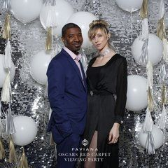 Beth Cooper and Mark Scantlebury in front of the glamorous balloon wall by SPS at the Faviana Oscars Red Carpet viewing party. Faviana's exclusive East Coast Oscar event on the rooftop of 75 Wall Street. #faviana #oscars #nyc #eastcoastoscars #redcarpet