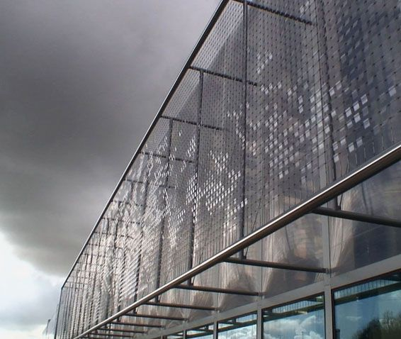 Utrecht, Office Facade Installation - The façade is made of a 300 square meter area of stainless steel mesh which holds thin transparent plastic disks. Wind causes the mesh to vibrate and move  the disks which 'ripple and create intricate patterns in the light'.