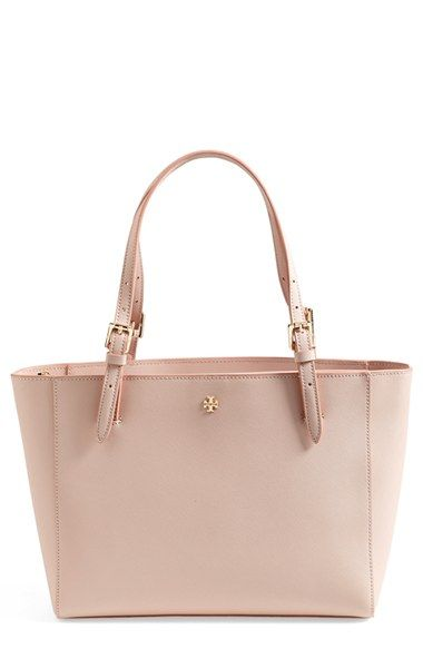 DEAR  Tory Burch 'Small York' Saffiano Leather Buckle Tote  Goldtone logo hardware perfectly complements the scratch-resistant Saffiano leather of a chic tote topped with slender, belted handles. Dual interior compartments with a center zip-pocket divider make it easy to stay organized, and the structured silhouette means that your tote holds its shape when you put it down.