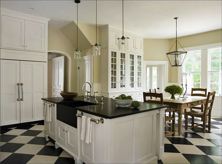 I've been in love with this kitchen for a long time! I love the black, tan, and white color scheme, the diamond floors, and the deep farm style sink!