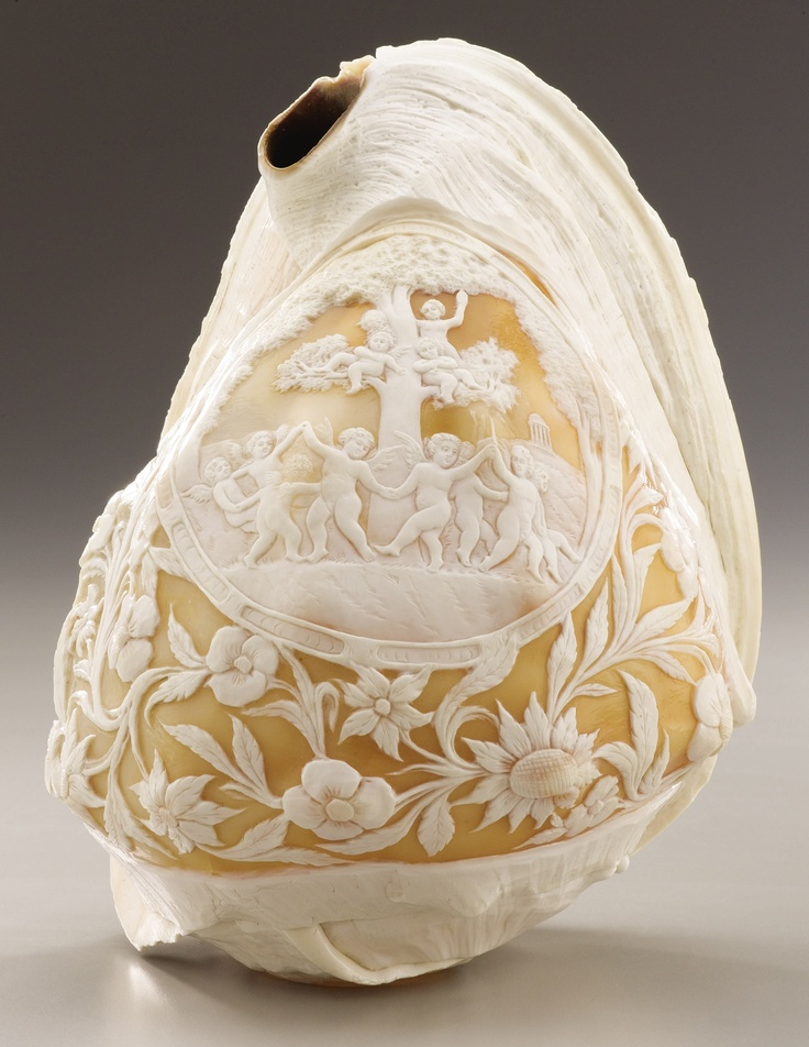 A POLISHED AND CARVED CONCH SHELL Possibly Italian