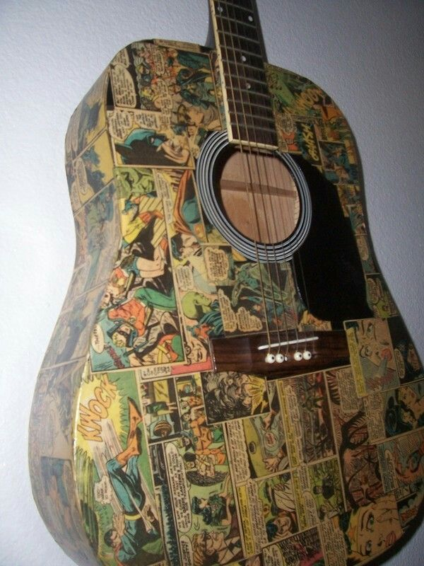 Guitar coated in pages from Old cartoons