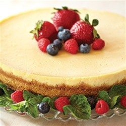 EAGLE BRAND(R) Sweetened Condensed Milk gives this cheesecake a creamy and smooth texture. Top with a raspberry spread, or serve plain.