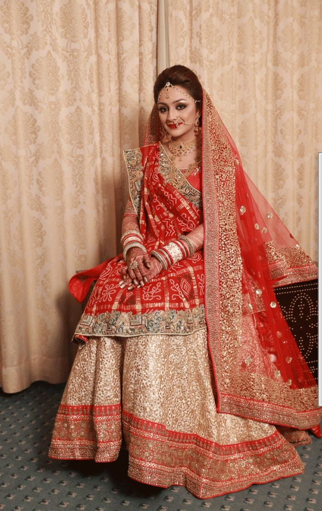 Gujarati Bride in traditional Panetar lehenga and Gharchola saree - Nidhi Sagar