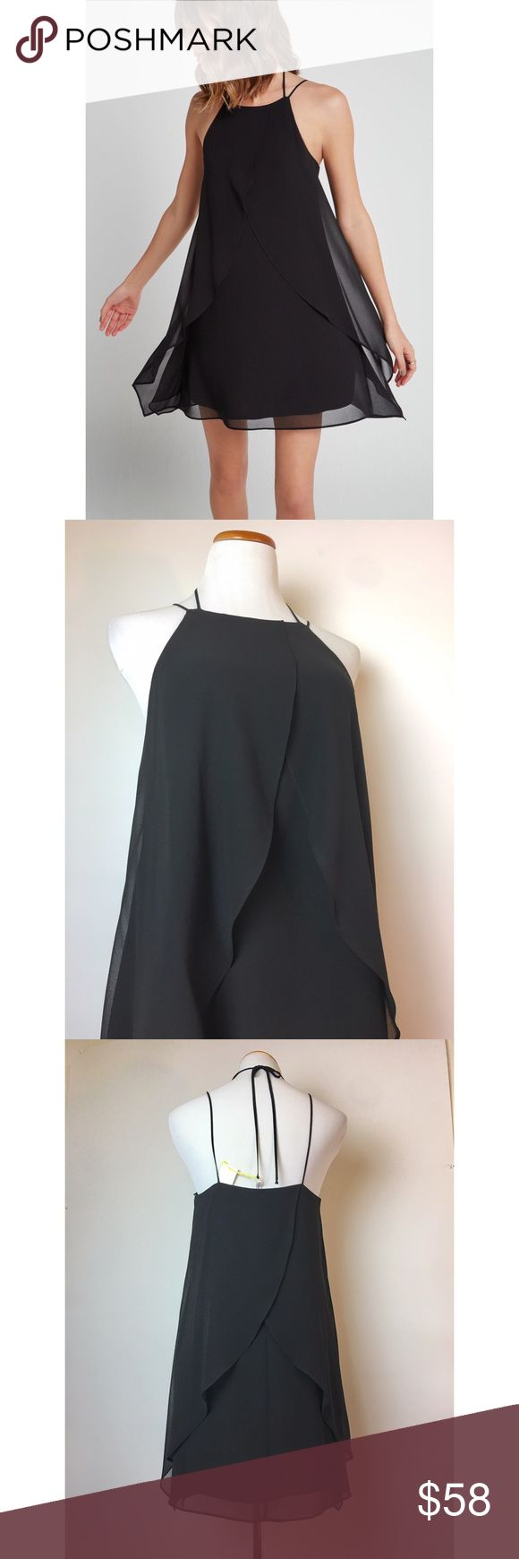 Stunning black ruffle halter dress Must have LBD by BCBGeneration. Chiffon slip dress that flutters as you move with cross ruffle overlay in front and back. Halter tie neck and straps. Fully lined. BCBGeneration Dresses