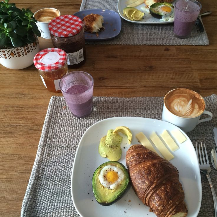 Baked egg in avocado, croissant, smoothie and latte!