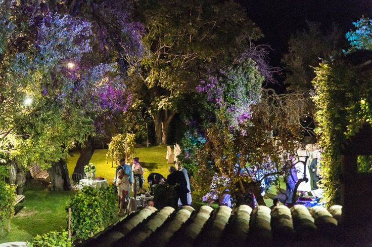 A night shot of the secret garden in the Castello at Semivicoli. Wedding party in full flow! Photographer, Jason Hales.