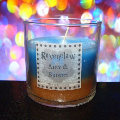 omg harry potter candles <3  Ravenclaw scented 4 oz candle: airy and bright