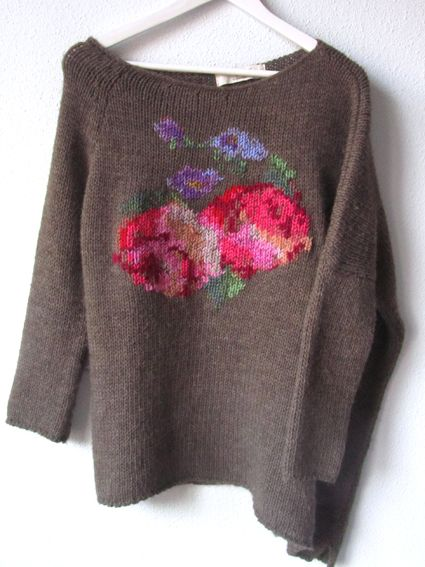 These flowers have been embroidered on afterwards - great way to customise an op-shop jumper!