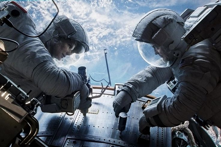 """Sandra Bullock and George Clooney in """"Gravity"""" (2013) - best film I've seen in a long time"""