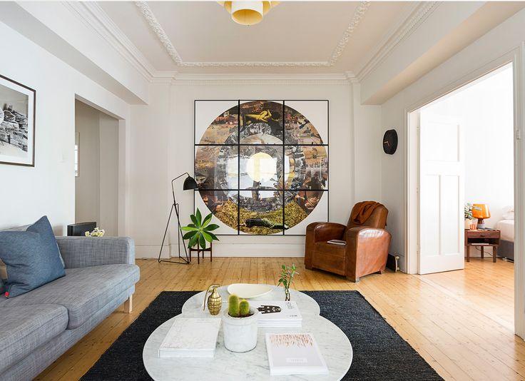 Lounge Room. TomMarkHenry Designers www.tommarkhenry.com   #interior #artwork #timberfloor #leatherseat #danishdesign #styling #marbletable