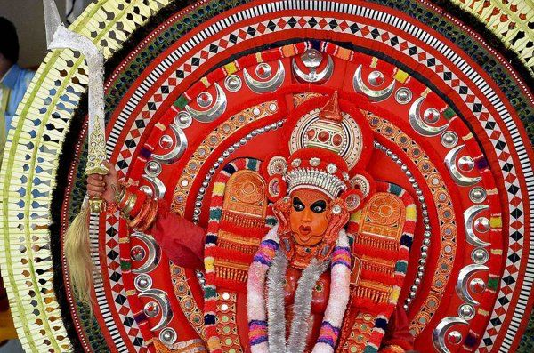 A Theyyam dancer in splendid colour. Let your photos speak up for India's heritage | Photo Gallery - Yahoo! Lifestyle India