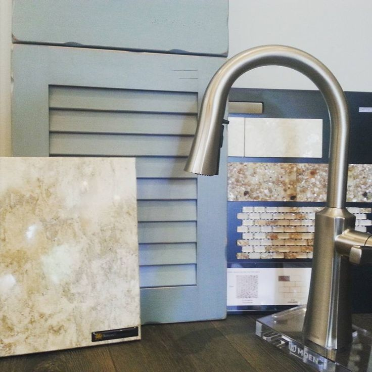 If you close your eyes, you can almost hear the waves! The coastal inspiration of the antique blue louver door from Woodharbor Custom Cabinetry, the @cambriaquartz countertop, glass tile and beautiful @moen faucet offers an inviting and relaxed feel to any kitchen. #FLHomeStore #remodel #interiordesign #jacksonville #staugustine #stjohns #renovation @flhomestore